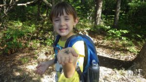 Boy holding young eastern fence lizard